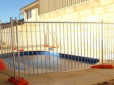 All round pipe Australia pool fences are installed surrounding the pool.